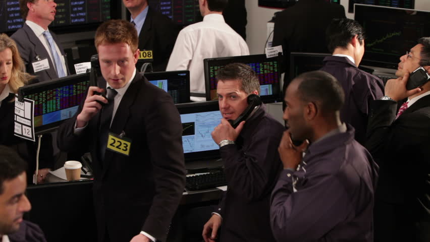 Crowd of financial traders in a Stock Exchange. Business people trading stocks and shares on an international scale. Trading currency, stocks and bonds.
