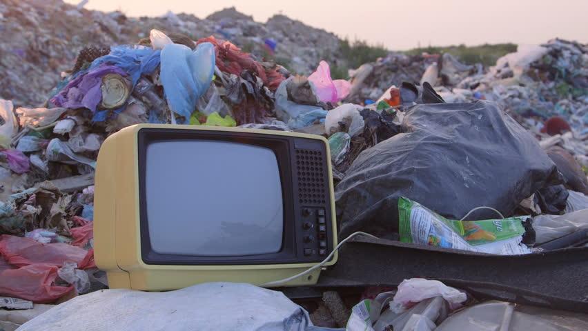 DOLLY: Old TV in Landfill