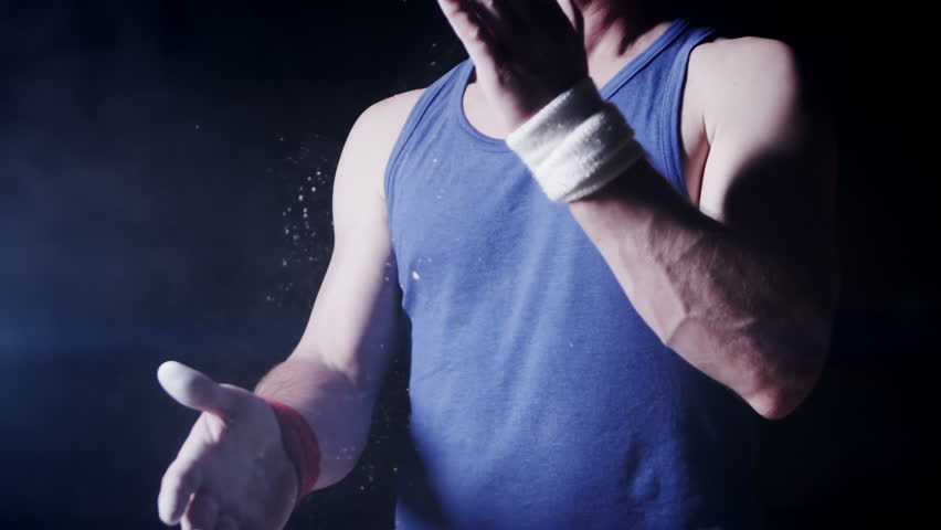 Gymnast chalking his hands in slow motion. Olympics sport in contemporary setting. Slow motion Shot on RED Epic at 240FPS