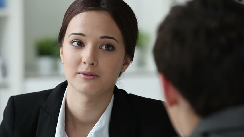 Hr department worker interviewing a male candidate for a vacant position