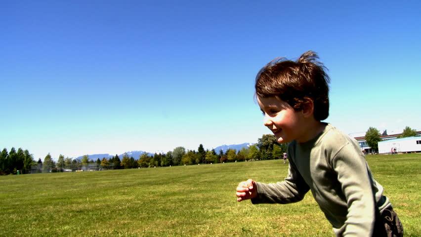 Little boy running outside
