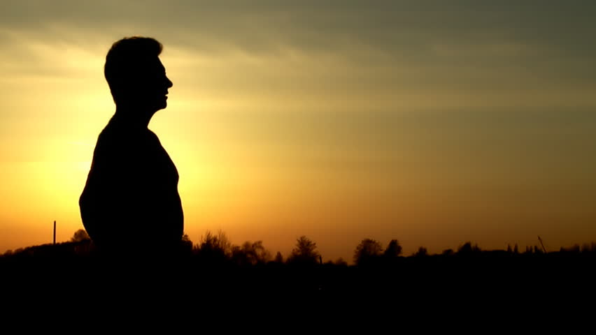 Man at sunset time saluting with sword | Shutterstock HD Video #456970
