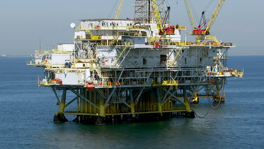 Aerial shot of off shore oil platforms - HD stock video clip