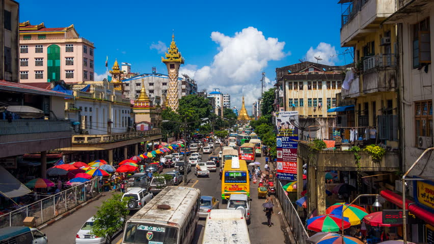 YANGON - AUG 13: Timelapse view of a busy street and ...