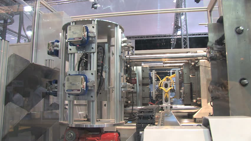 Automated machinery from a factory making containers  - HD stock footage clip