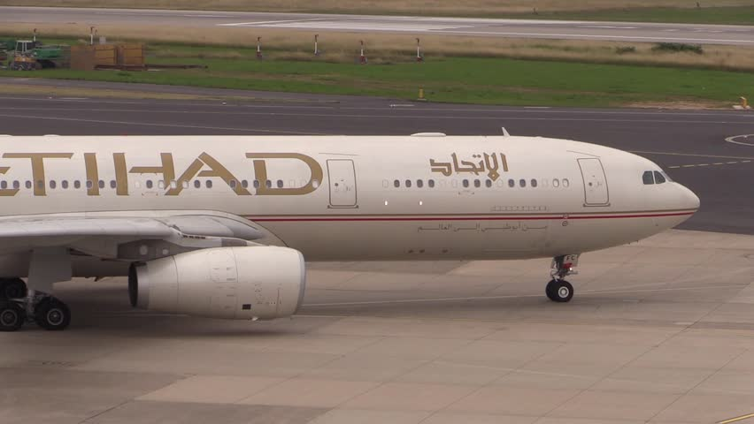 DUSSELDORF AIRPORT, GERMANY - JULY 12 2013: Etihad Airways on taxiway