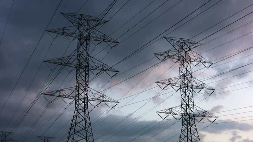 Electrical pylons with timelapse clouds. Jets fly by. - HD stock video clip