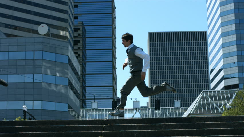 Business men running in city, slow motion