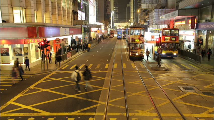 China - January 2012: POV driving time lapse at night on an electric tram in central Hong Kong, China, in January, 2012