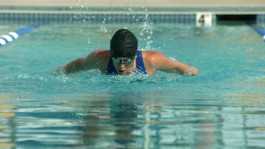 Swimmer doing butterfly stroke, super slow motion