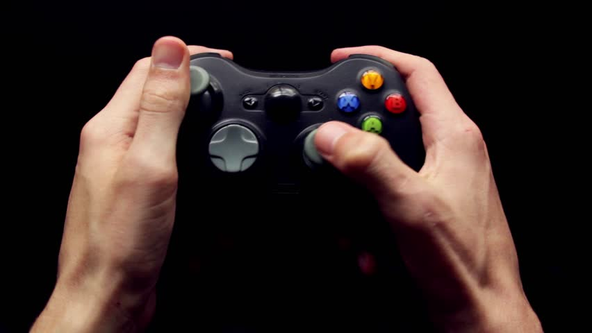 A gamer plays Xbox on a wireless controller. - HD stock video clip