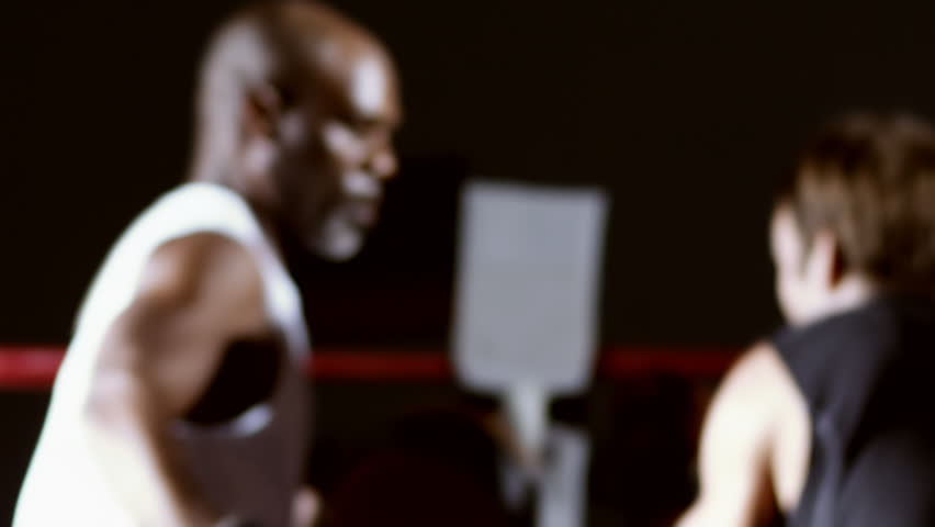 Male athlete works on his punching with a coach. Medium shot. - HD stock footage clip