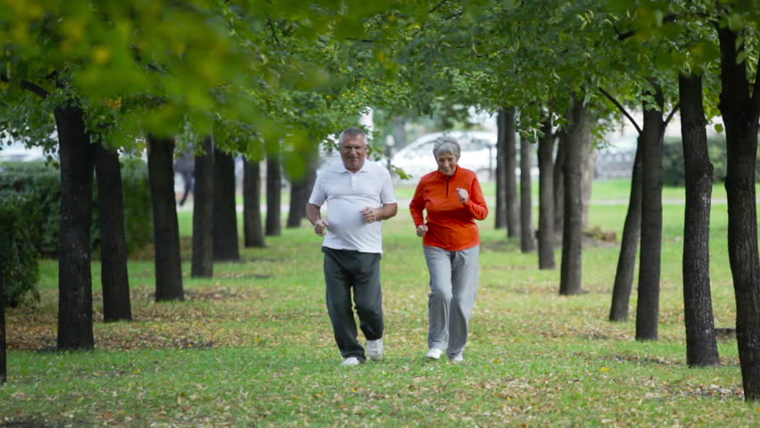 Retired couple keeping fit jogging in the park