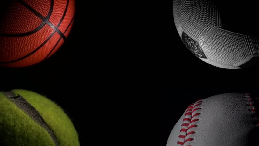 Sports balls against black loop - HD stock footage clip