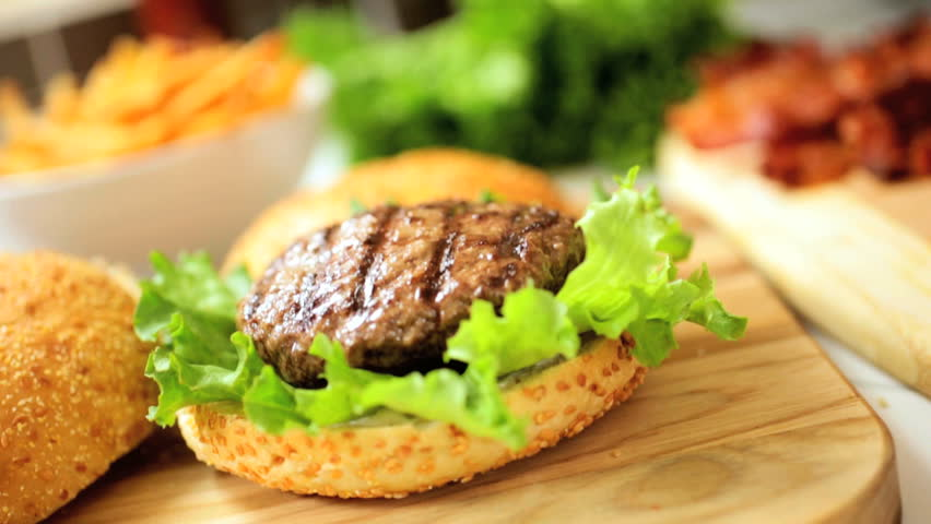 ... beef tomato, and a juicy ground beef burger - HD stock video clip