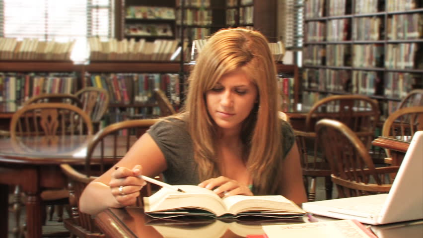 Students study in the library. - HD stock footage clip