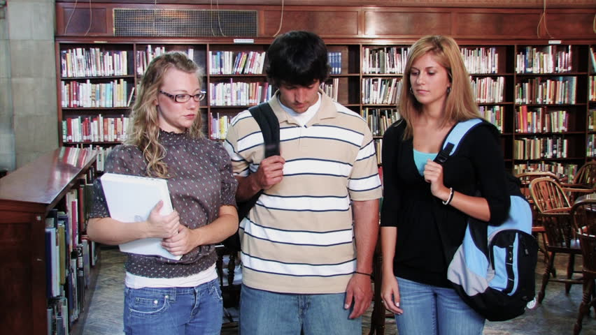A confident group of students proudly look at the camera and smiles. - HD stock footage clip