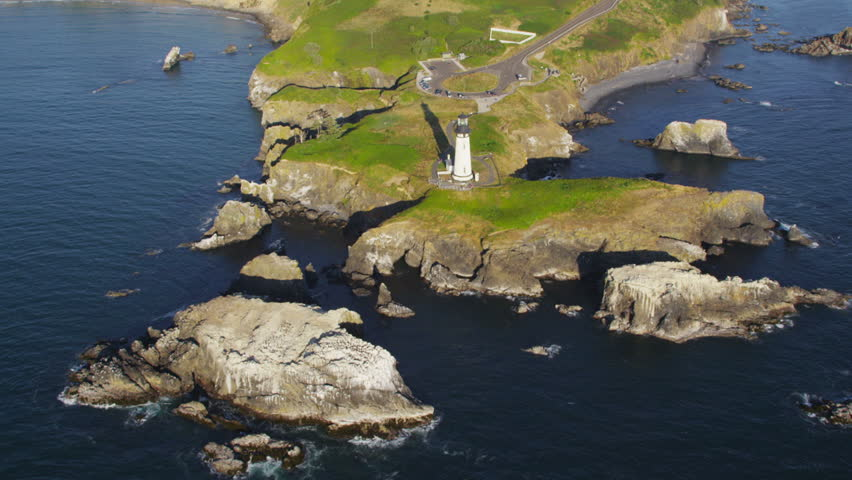 Aerial view of lighthouse on coastline - HD stock footage clip