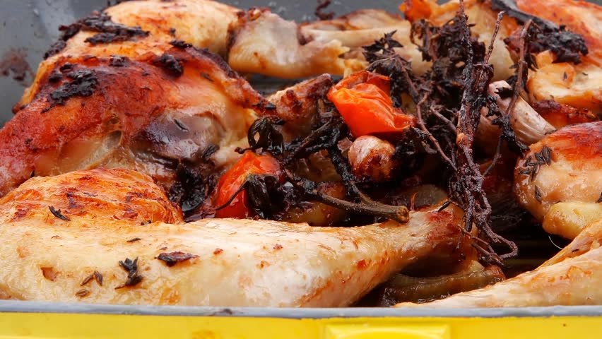 grilled chicken legs with tomatoes and thyme cooked on yellow ceramic pan 1920x1080 intro motion slow hidef hd