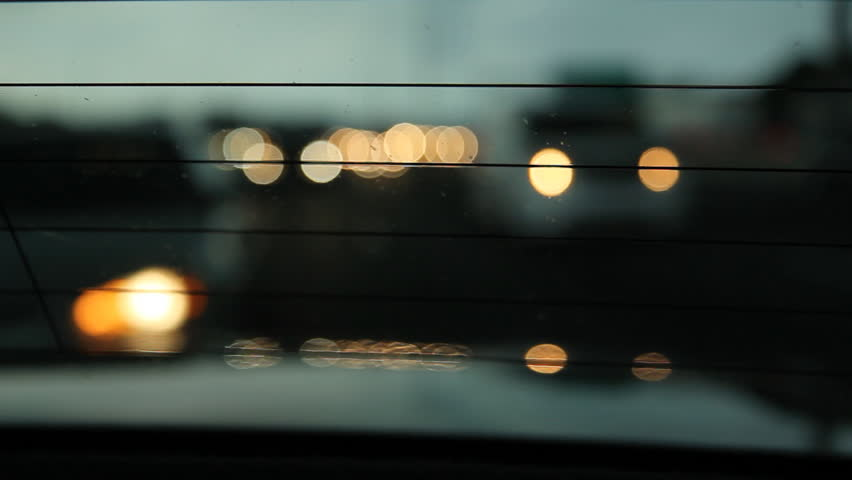 View through rear car window.