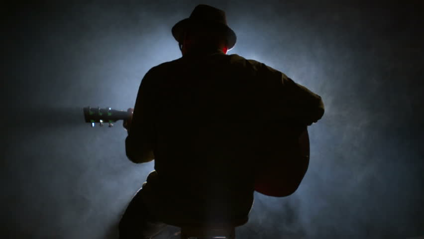A silhouette of a guitar player sitting on a stool - HD ...