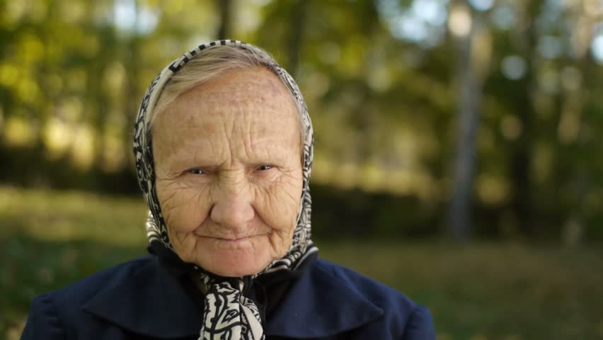 old person outdoors portrait closeup - HD stock video clip