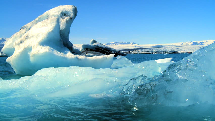 Glacial ice slowly melting into the lake through global warming 60 FPS - HD stock video clip