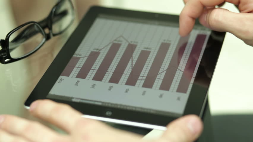 Office worker using a touchpad to analyze statistical data