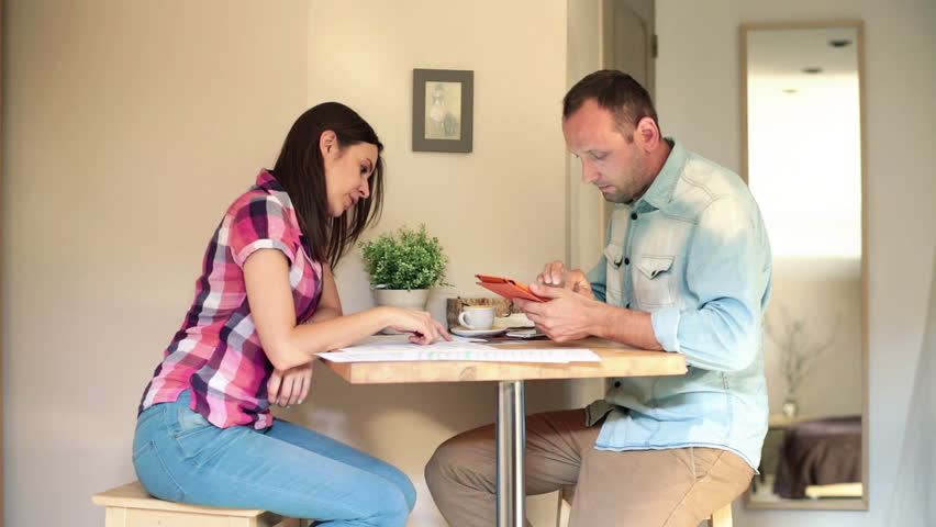 Young couple with bills and tablet computer at home  - HD stock footage clip