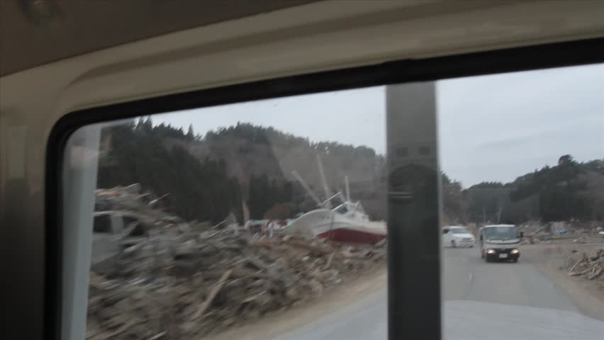 JAPAN - April 2011: Driving through wreckage and tsunami destruction by truck