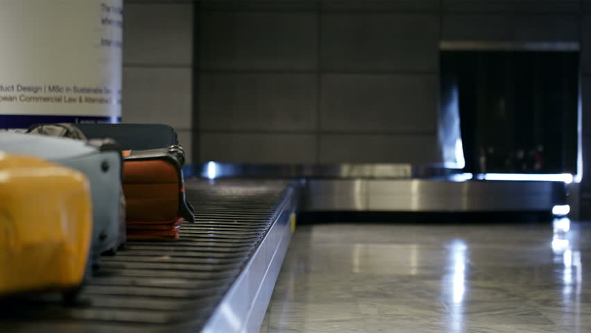 Baggage conveyor belt in the airport carrying the passenger luggage
