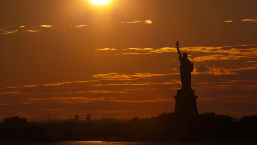 Sunset behind statue of liberty