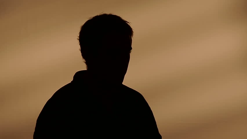 Male silhouette calling on the phone
