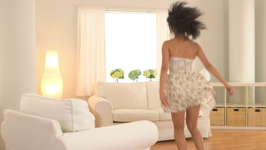 living room dancers jumps into white s arms stock footage 10698
