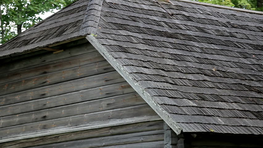 reddish brown tar oiled cedar wooden shingle roof of the On log cabin roof shingles