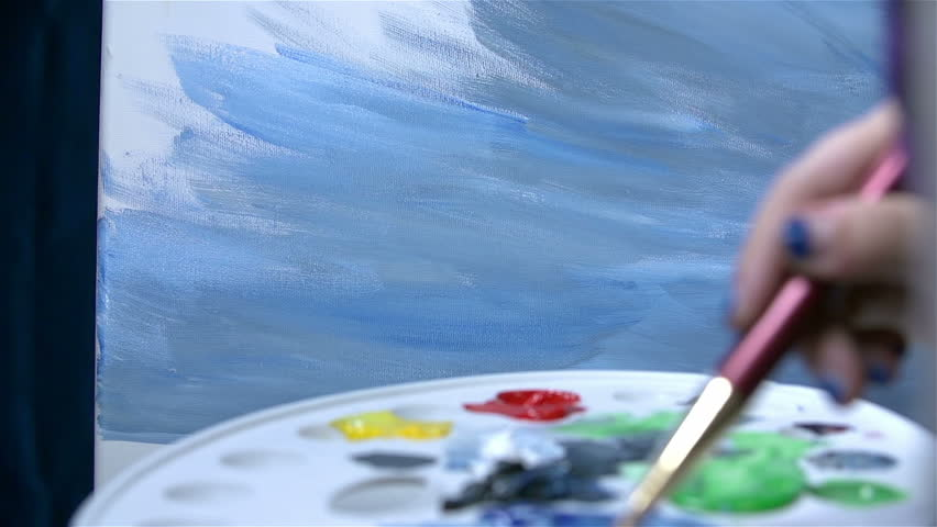 Working on a landscape painting with palette in front - HD stock video clip