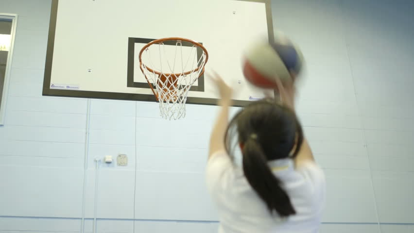 MS Girl playing basket ball in court