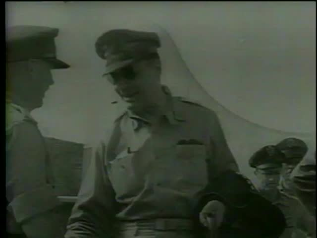 General MacArthur shakes hands with officers leaving for the USA after the end of WWII, Philippines circa 1945 - MGM PICTURES, UNIVERSAL-INTERNATIONAL NEWSREEL, USA,filmed in 1964