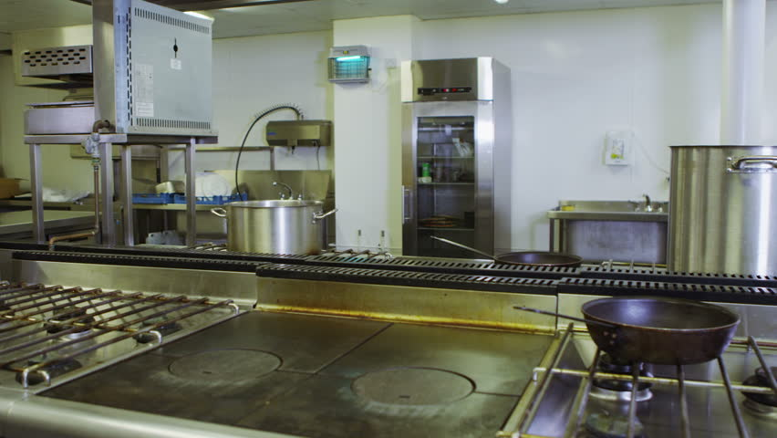 View around an empty commercial kitchen with no people. - HD stock video clip
