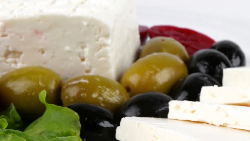 served greek dinner on dish with vegetables 1920x1080 intro motion slow hidef hd