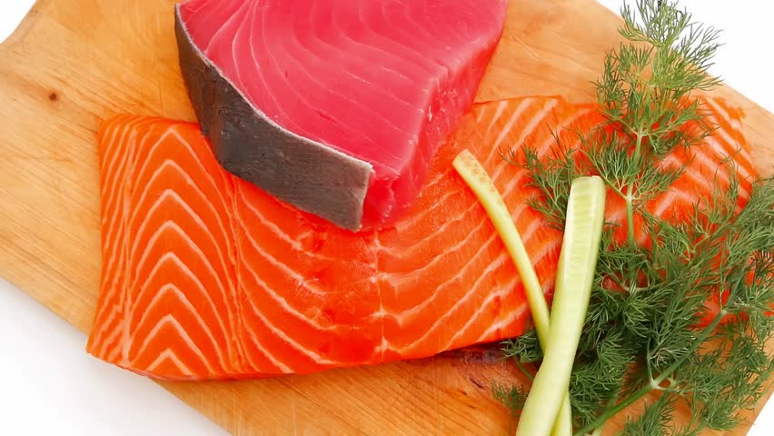 fresh raw salmon and red tuna fish pieces over wooden board 1920x1080 intro motion slow hidef hd