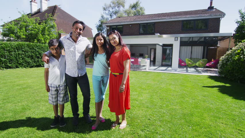 Portrait Of Happy Young Asian Family, Standing In The ... Happy Asian Family In Front Of House