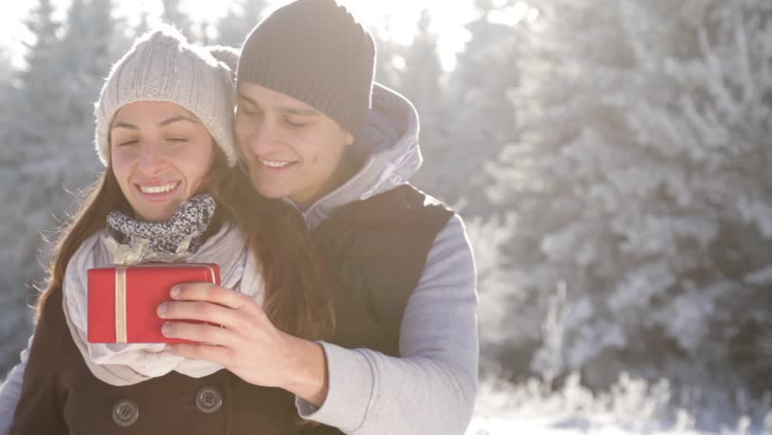 Christmas Surprise Present Young Couple Outdoors