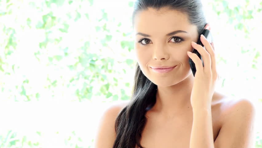 Beautiful Girl is using mobile phone - HD stock footage clip