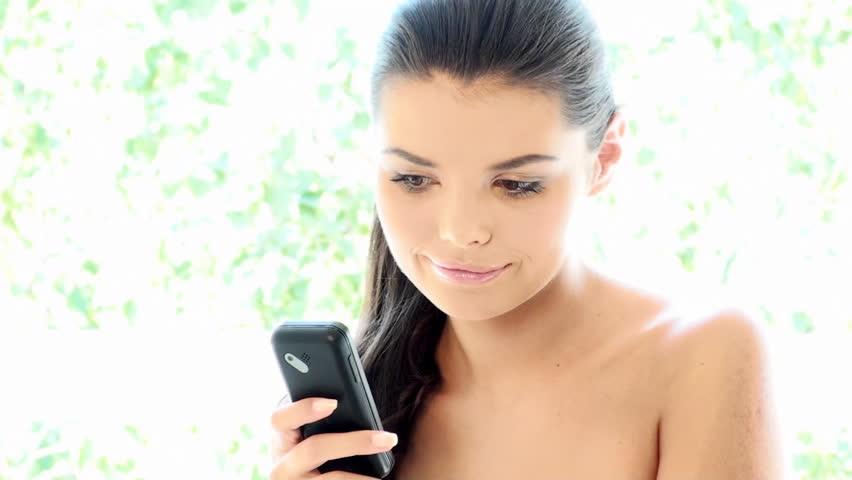 Beautiful Girl is using mobile phone