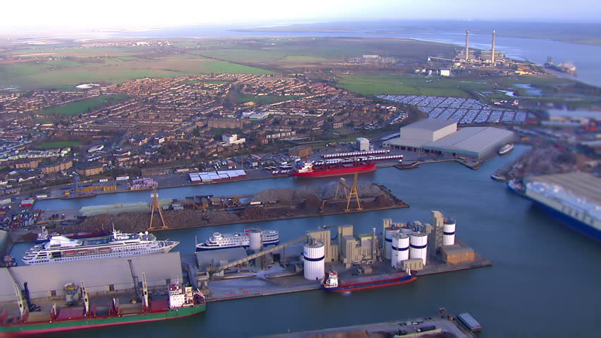 Aerial view of docks and industrial area on the outskirts of London, UK - HD stock video clip