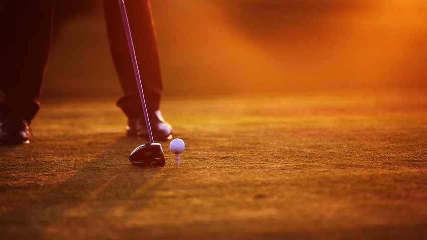 Golf player teeing off on beautiful golf course during dawn - HD stock video clip