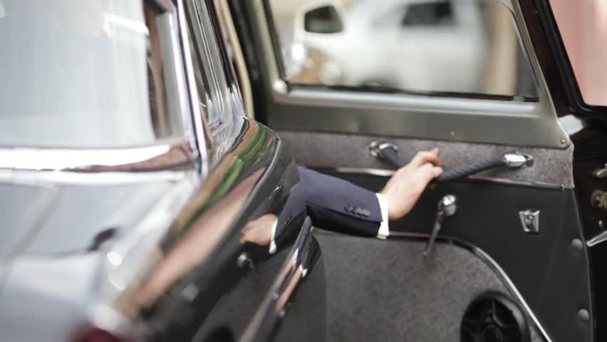 Man from cabin door opens and closes old car door - HD stock video clip