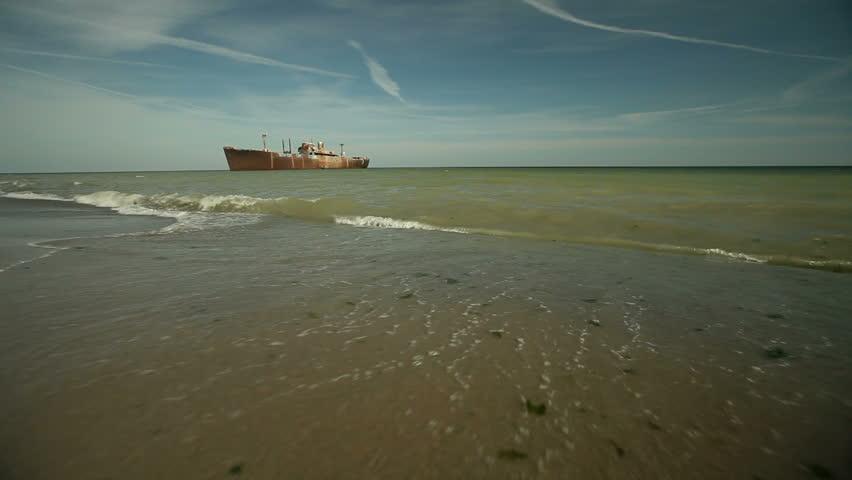 Ship wreckage and beach. - HD stock video clip