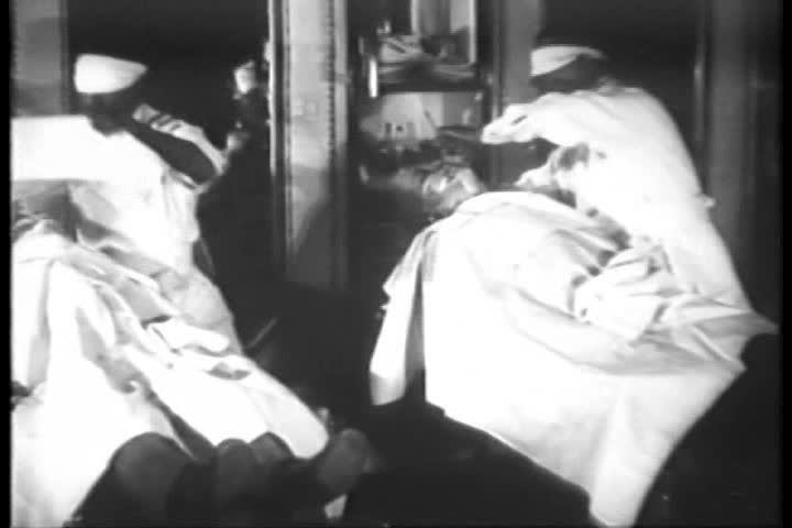 Blindfold barbers compete in a shaving race in 1930. - SD stock video clip
